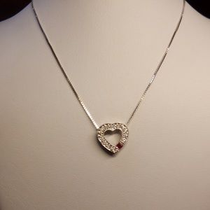 18k white gold stamped white pendant with ruby.
